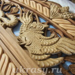 Резной  деревянный наличник с панно на дверь (окно). Резьба по дереву